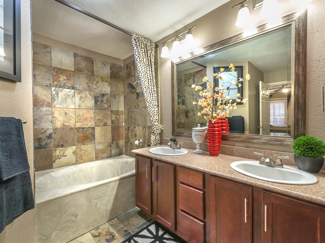 Bathroom with dual vanity and roman tub