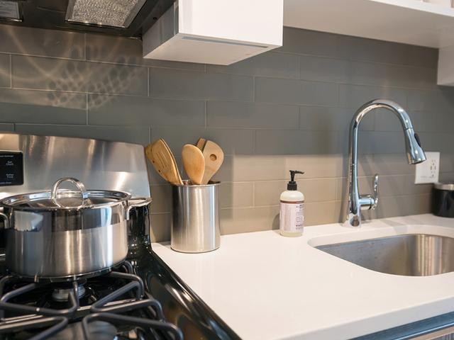 Tile backsplash and quartz countertops