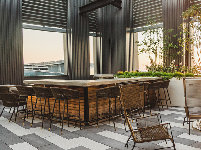 Rooftop outdoor lounge with wine bar and demo kitchen