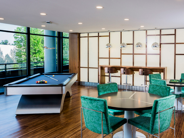 Resident lounge with billiards table and seating