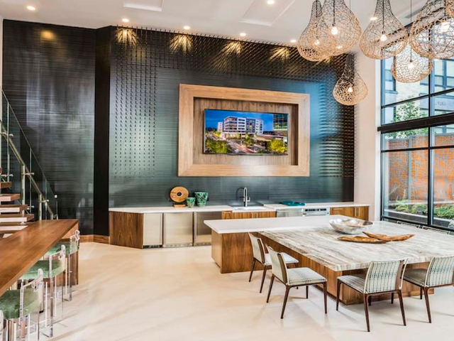 Resident lounge with large countertop seating and kitchen