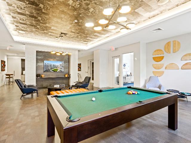 Pool table room image at Modera Framingham