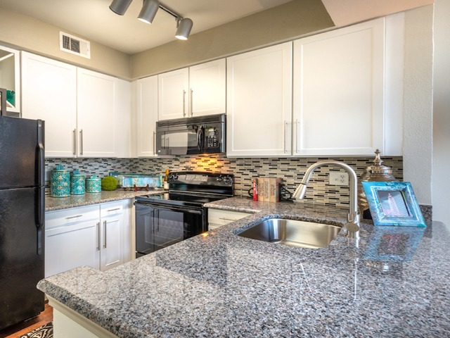 Furnished kitchen with granite countertops