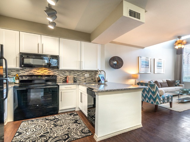 Kitchen with open concept breakfast bar