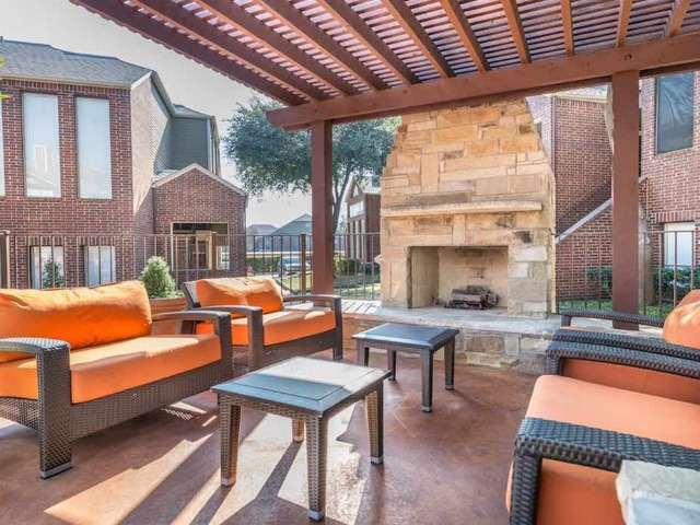 Outdoor fireplace with ample seating