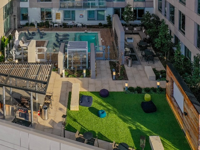 Rooftop lounge pool, grilling area, and outdoor theatre