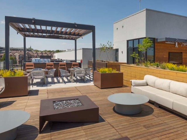 Outdoor dining area and BBQ grilling stations with panoramic city views