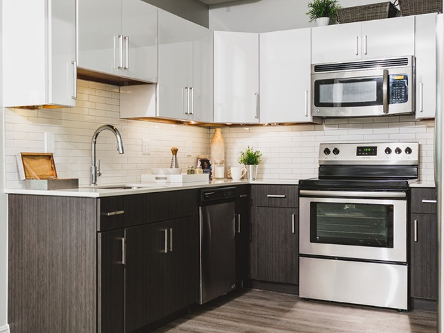 Modern two tone cabinetry with chrome pulls
