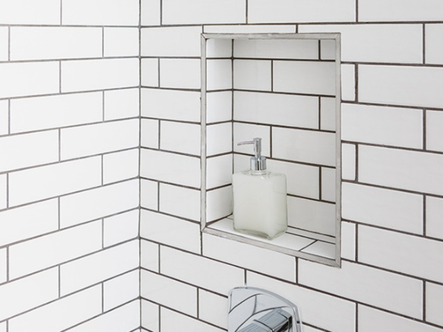 Spa-inspired shower with storage insert and modern subway tile