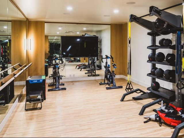 Yoga studio with spin bikes and TRX equipment and ballet barre