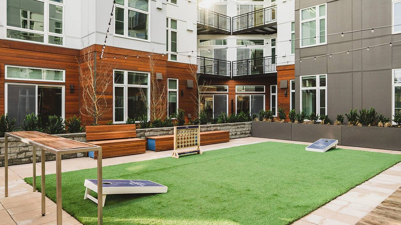 Outdoor courtyard with BBQ, fire pit & lawn games