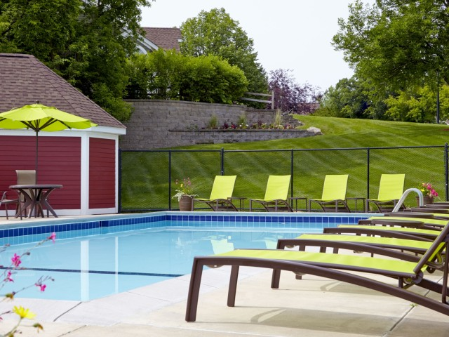 Image of Outdoor heated swimming pool with sundeck for Bass Lake Hills Townhomes