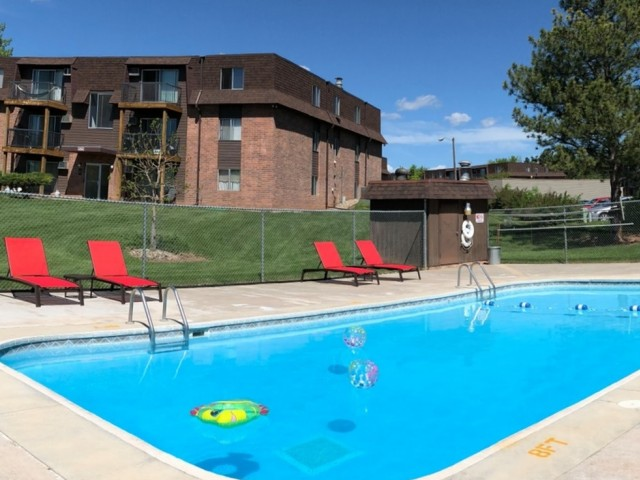 Image of Outdoor, heated swimming pool with sundeck for Candlewood Apartments