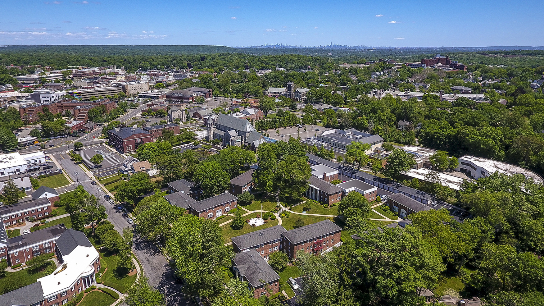 Aerial view of The Parc at Summit apartment grounds and city view in Summit, NJ