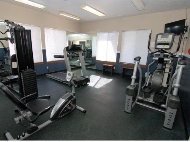 Workout room with multiple pieces of exercise equipment