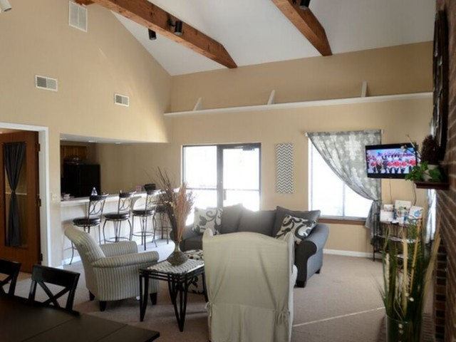 Clubhouse at Cambridge with multiple seating areas and TV