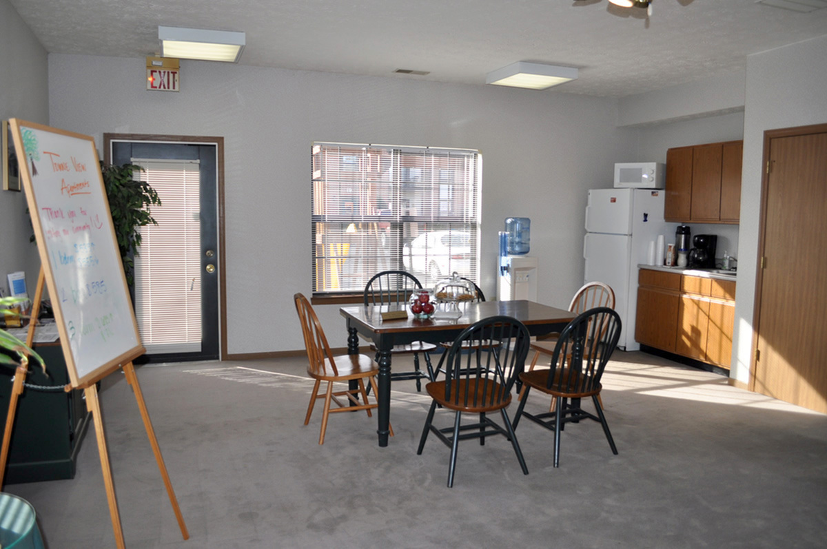 Community center with large table and coffee area
