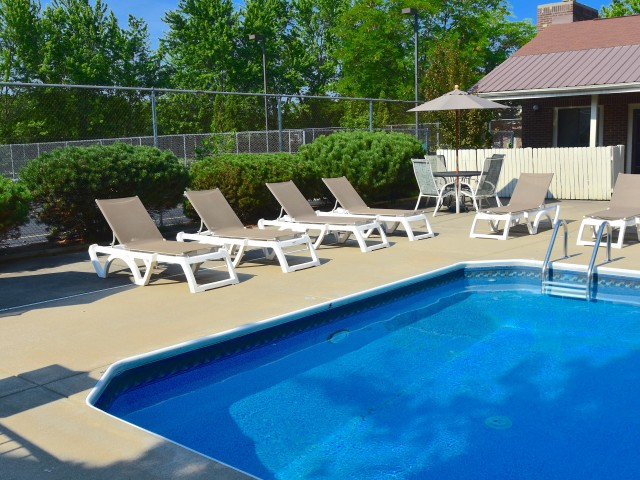 Pool with multiple pool chairs surrounding