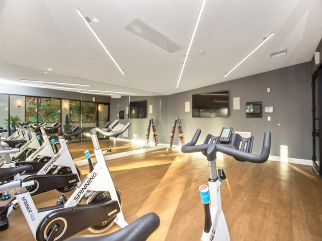 Fitness studio with spin bikes.
