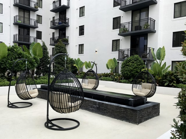 Serenity Garden with fountain and egg chairs.