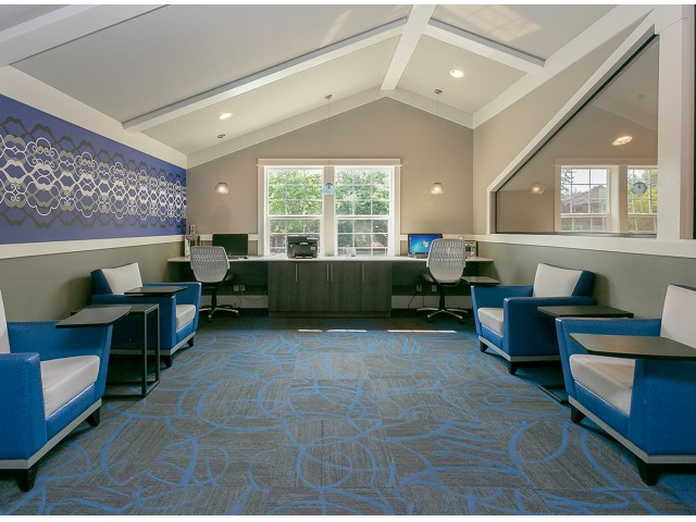 Leasing office with blue waiting chairs.