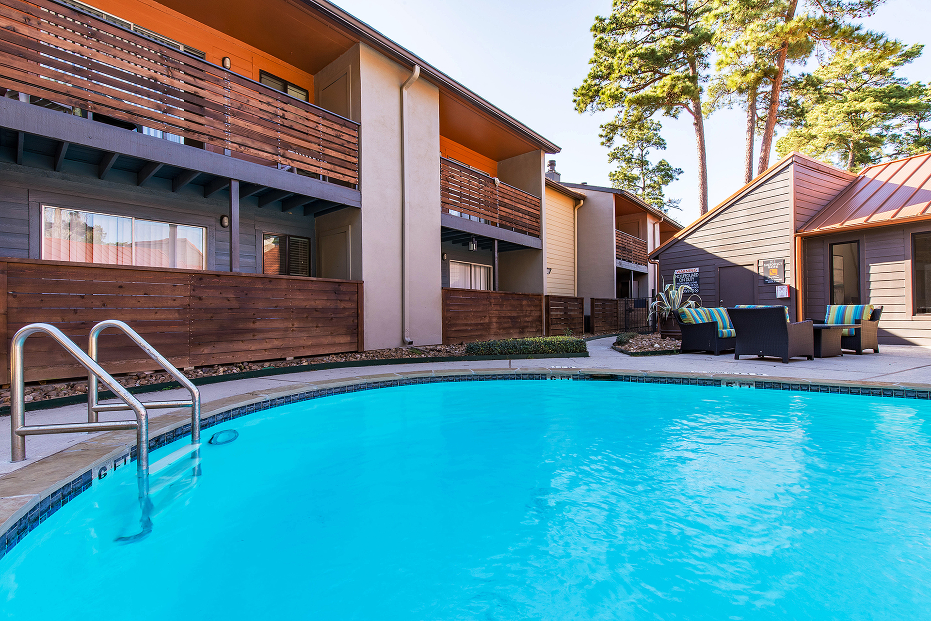 Apartments Houston-Copper Lodge Swimming Pool with Seating Area Nearby and Clubhouse