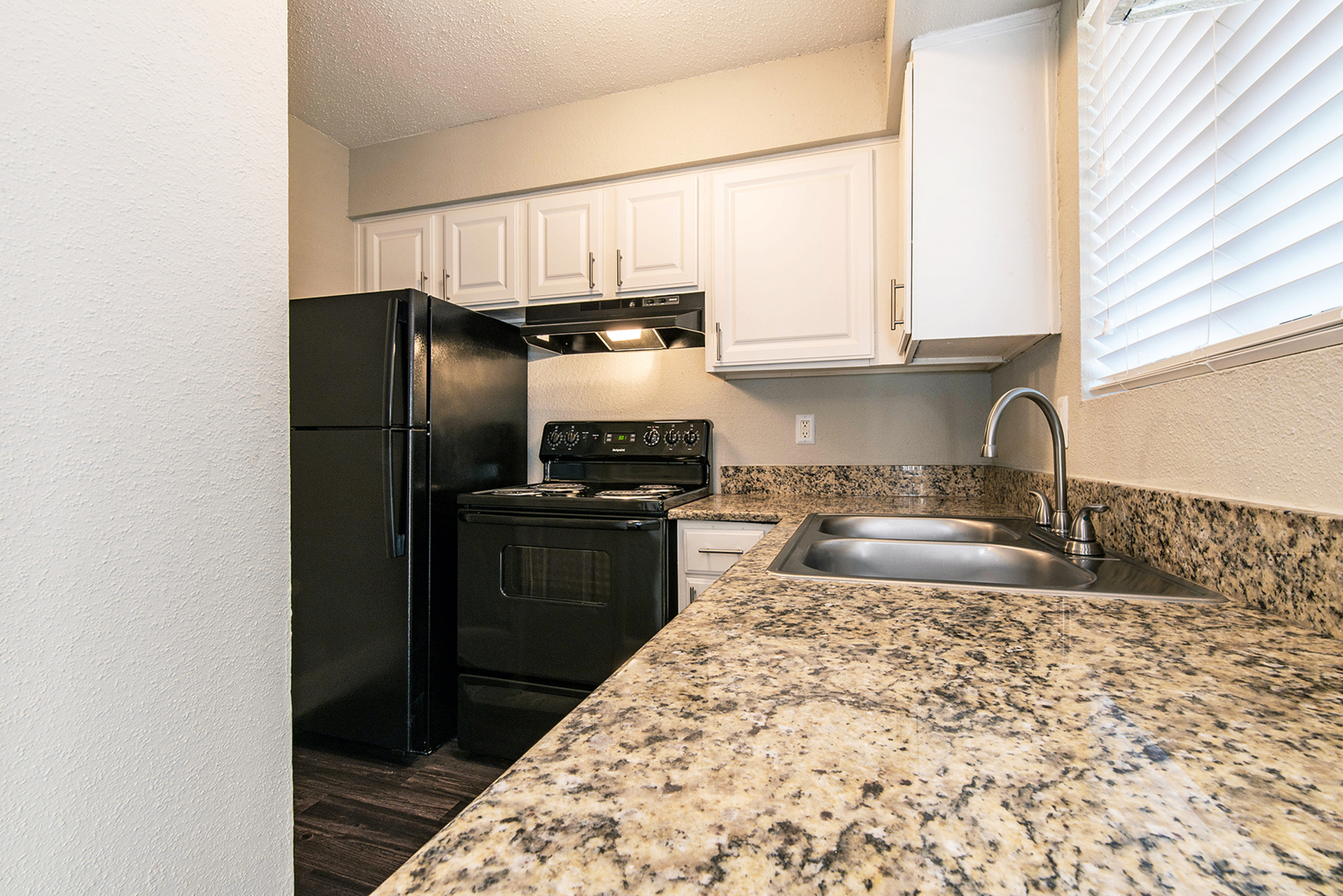 Apartments for Rent in Houston-Copper Lodge Modern Kitchen with Double Sink and Matching Stainless Steel Appliances