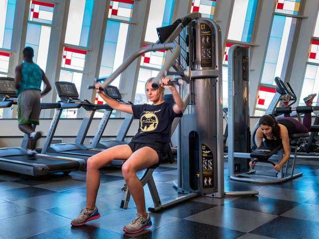 fitness center with treadmills, resistance trainers, and more