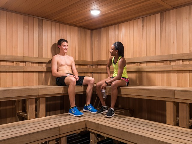 two residents relaxing in the community sauna