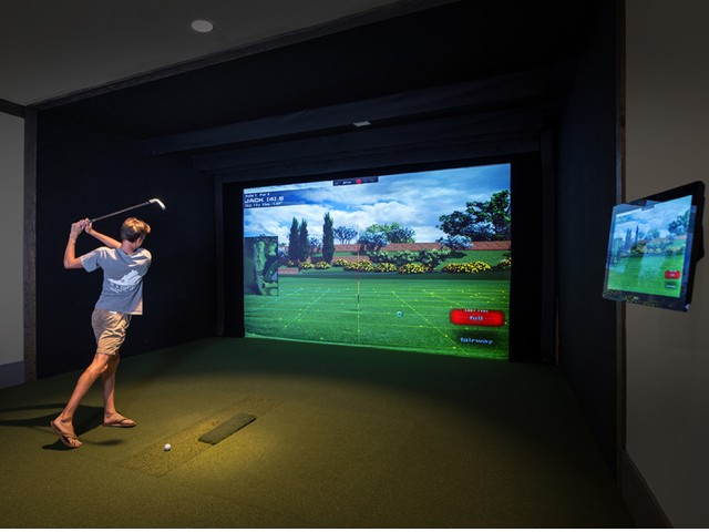 Resident Enjoying a Golf Simulator