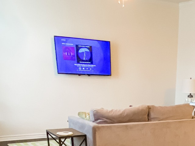 "Wall Mounted 50"" Smart TV in Living Room"