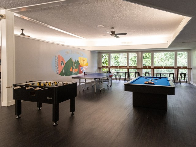 game room with pingpong, foosball, and billiards tables