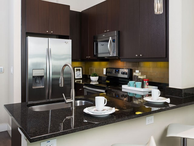 Image of Granite countertops with glass tile backsplashes for 4110 Fairmount