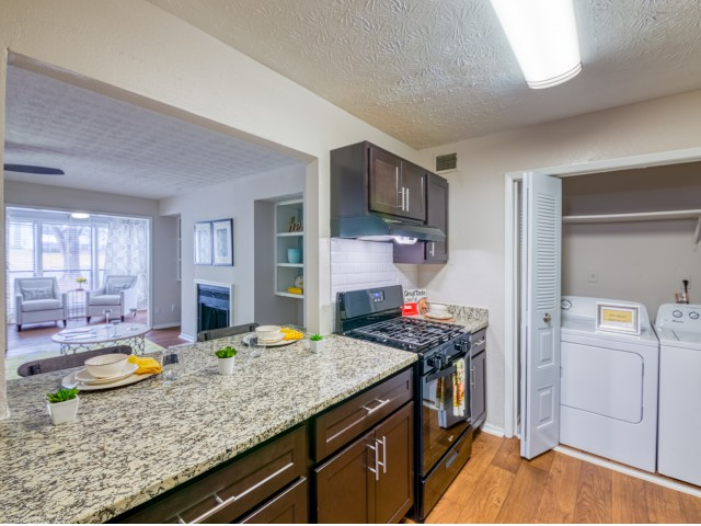 Image of Newly Renovated Kitchens Featuring Black Whirlpool® Appliances and Undermount Sinks. for Avana Druid Hills