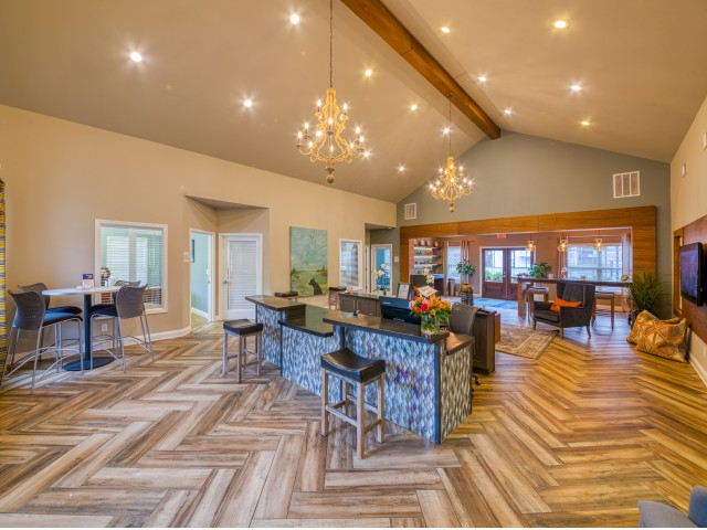 Relax in the welcoming clubhouse featuring Wi-Fi, a full kitchen, comfortable seating, and conference areas.