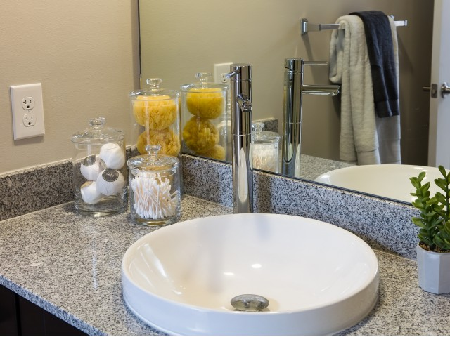 Image of Granite bathroom countertops and artistic basin sinks for Caspian Delray Beach