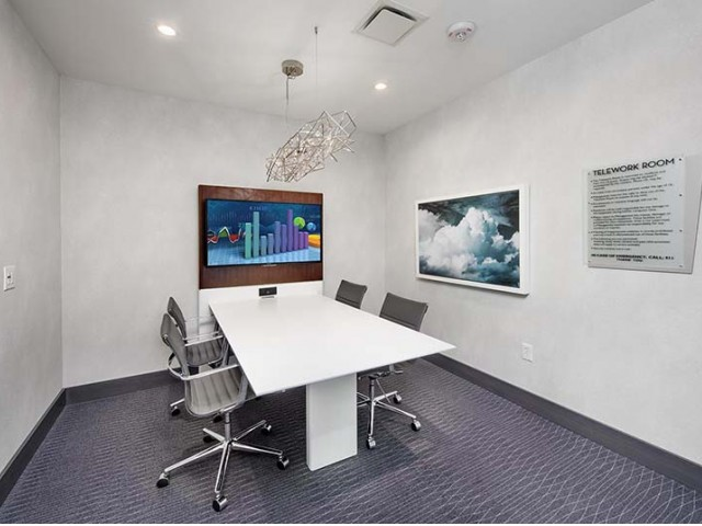 Image of Business Center with Two Secluded Workstations and A Conference Room for Ascent Uptown