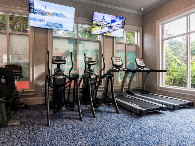 Renovated fitness center with cardio equipment