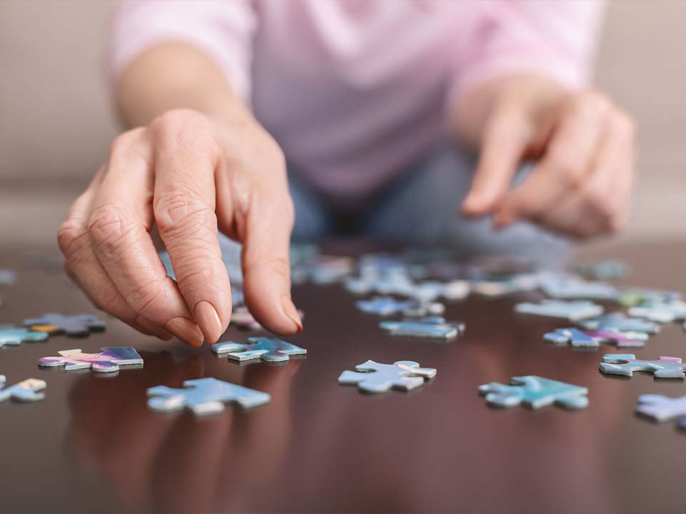Elderly woman's hands doing a puzzle