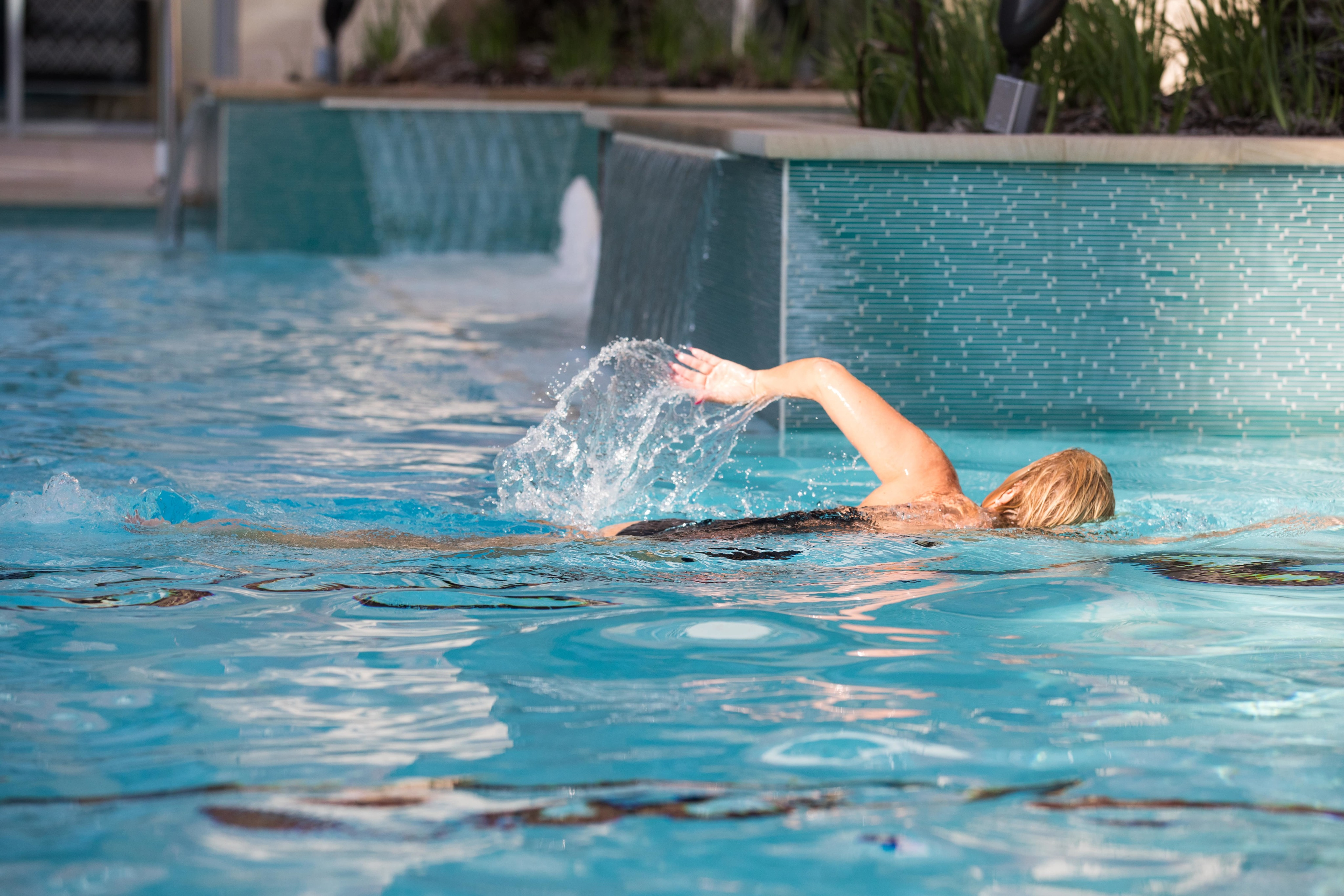 enior-female-swimming-in-Overture-pool