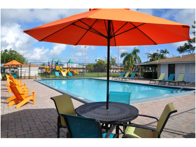 Image of Refreshing Swimming Pool with Sundeck and Outdoor Showers for Pompano Palms Apartments