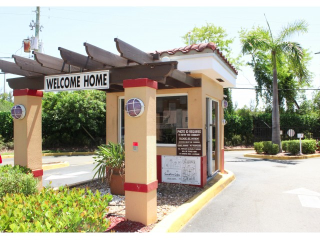 Image of Gated Entry with Electronic Access & 24-Hour attended Gate House for Sunshine Lakes Apartments