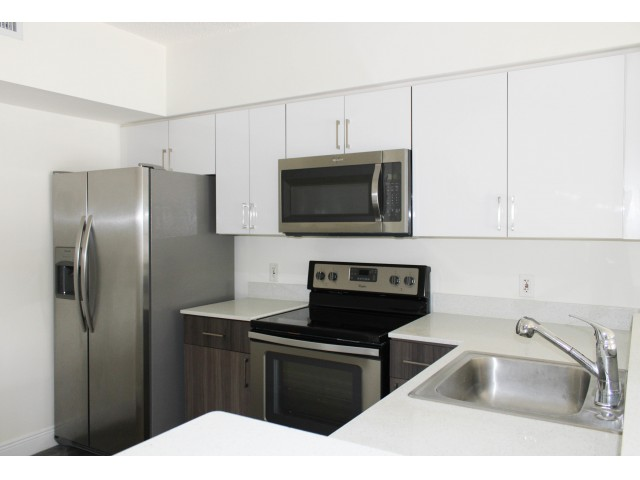 Image of Quartz Countertops With Dual Tone Cabinetry* for Royal Palms Apartments
