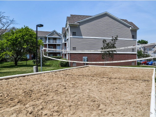 Campus Court at Red Mile Apartments Lifestyle - Volleyball Court