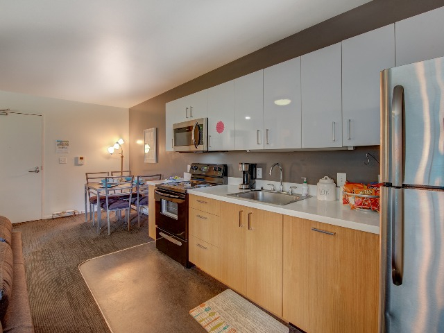 Skybox Apartments Furnished Apartment Kitchen And Dining Room