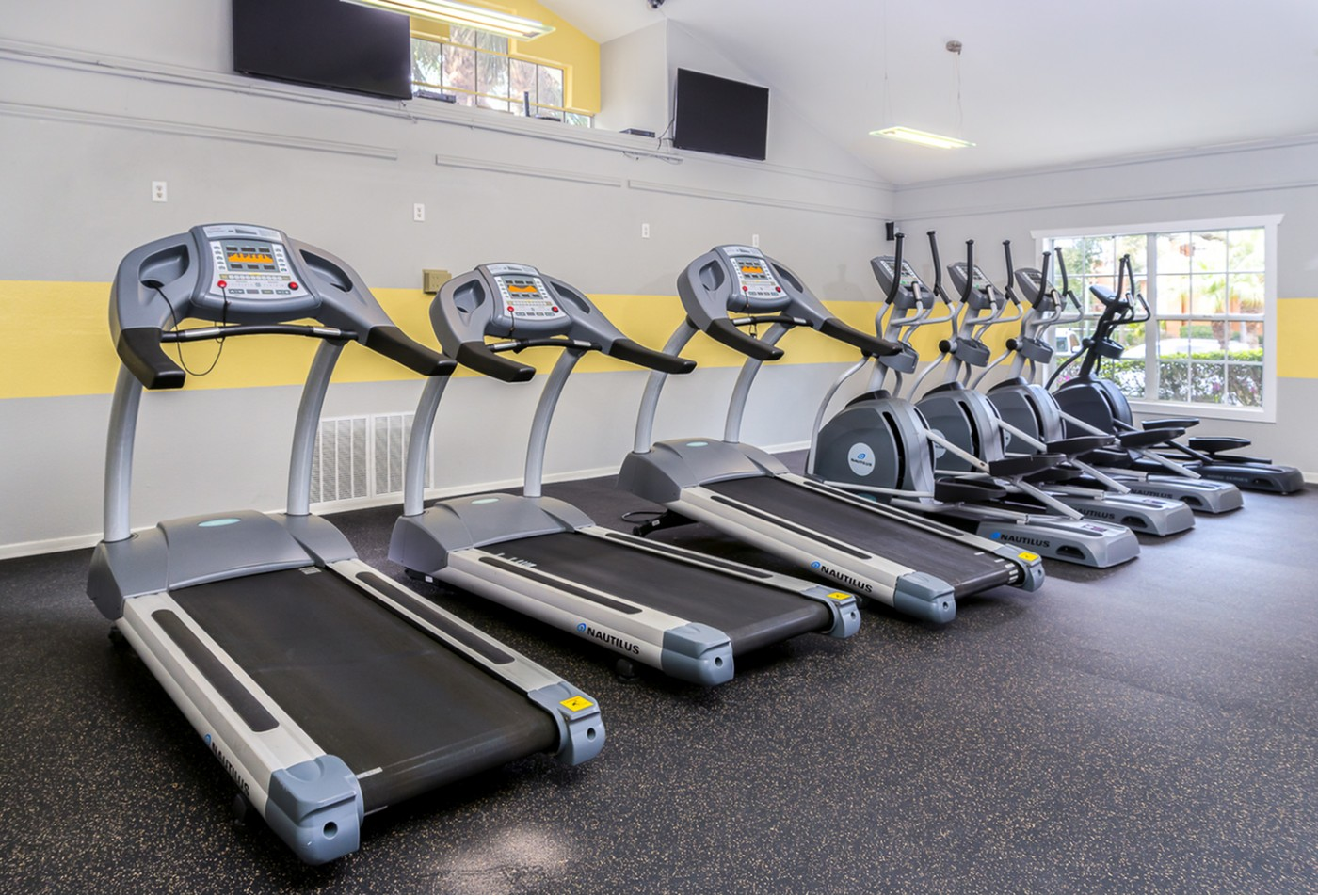 Fitness center with treadmills and spinning equipment.