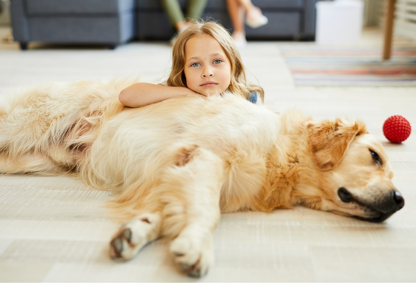 girl with labrador relaxing in living room