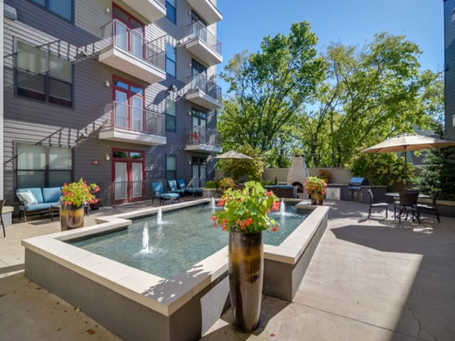 Image of Relaxing Courtyard with Fountain for Note 16 Apartments