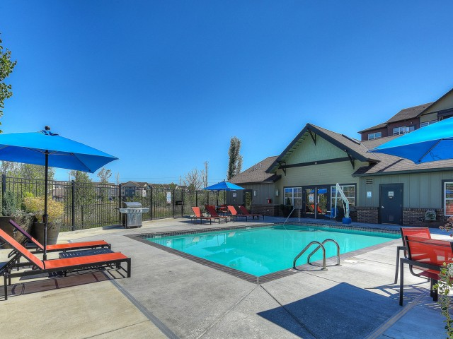 Image of Sparkling Pool with Large Sundeck and Outdoor Shower for Element 170 Apartments