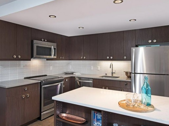 Image of Quality Appliances, Contemporary Cabinetry & a Culinary Island for Panorama Apartments
